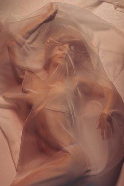 woman lying under the veil