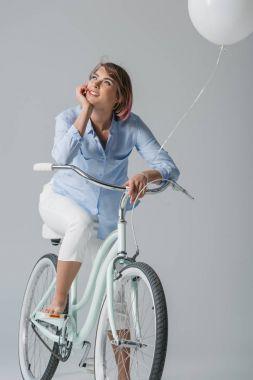 dreamy girl sitting on bike