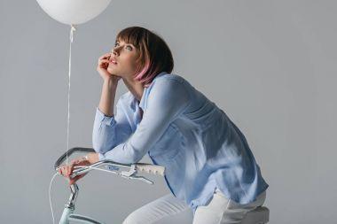 dreamy girl on bike with balloon