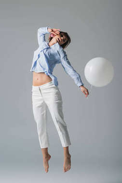 girl jumping with balloon