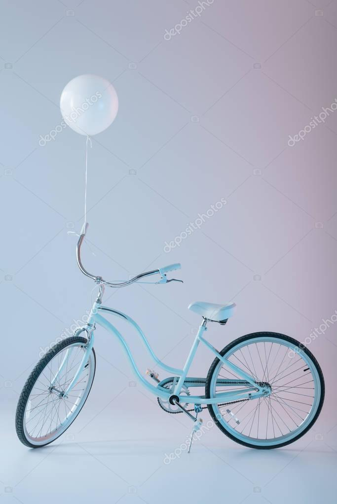 bicycle with white balloon