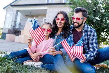 family with american flags and sunglasses