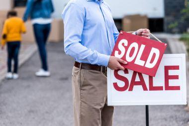 realtor hanging sold sign