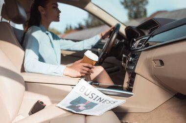 business newspaper in car