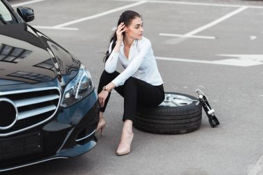 woman sitting on tire