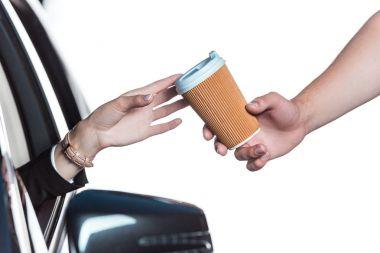 Woman getting coffee in drive-through