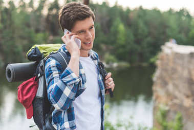 hiker talking by phone