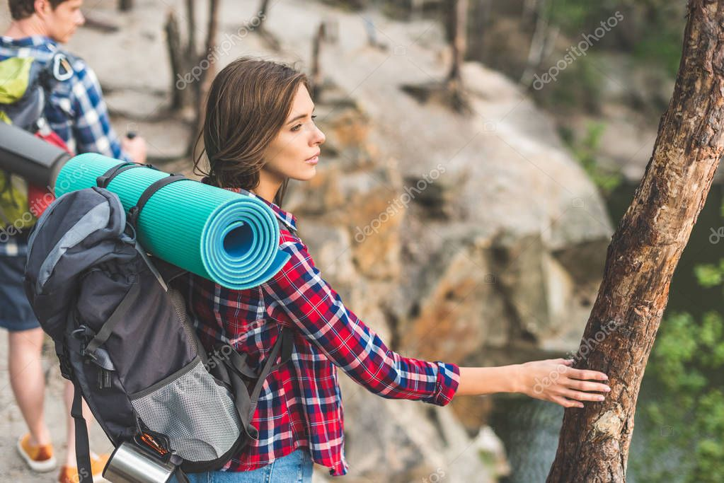 active couple with backpacks