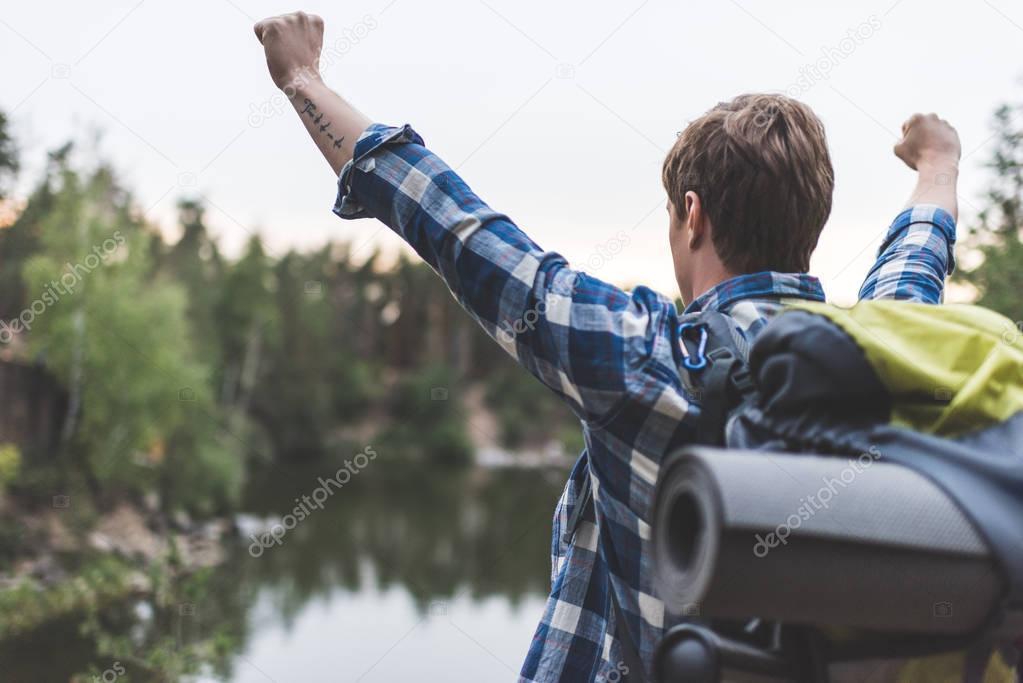 hiker celebrating victory