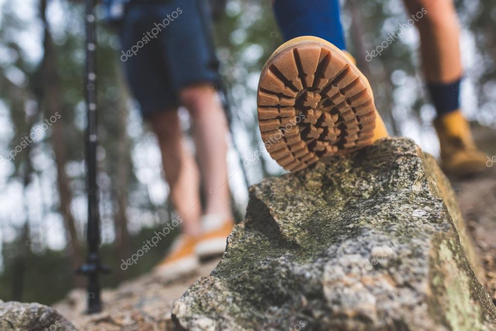 boot standing on rock