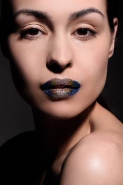 Woman with glitter lips