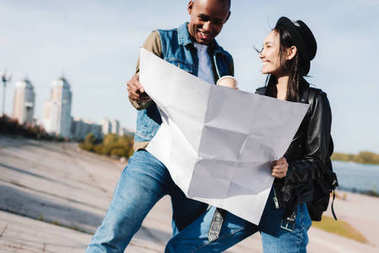 multicultural couple with map