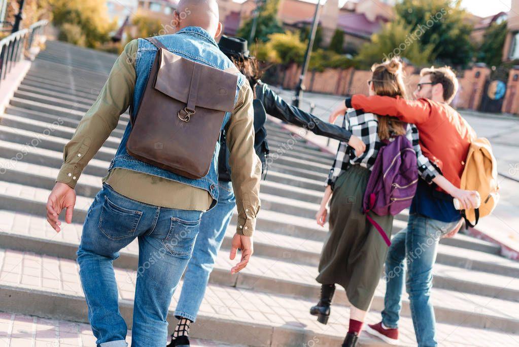 Multicultural friends walking on street