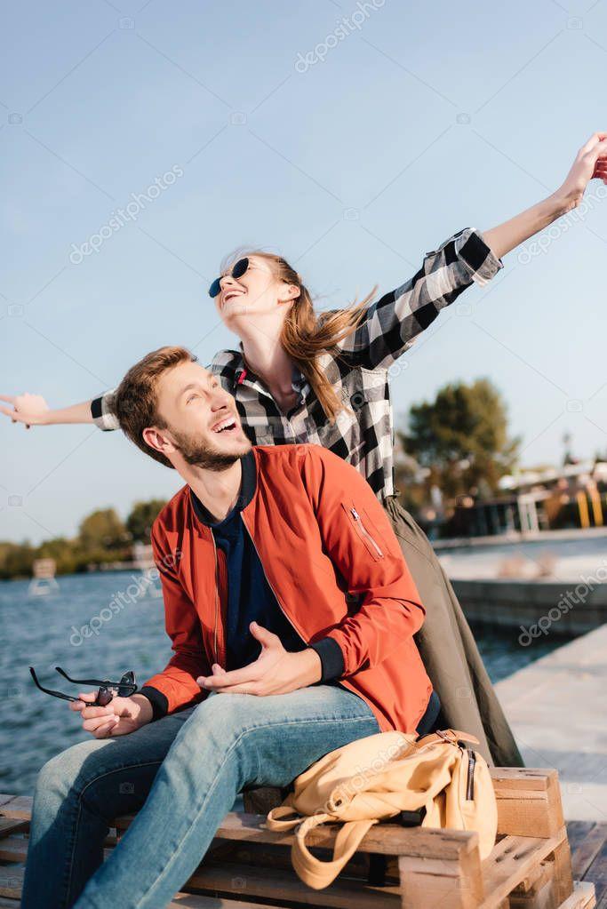 Happy couple on pier