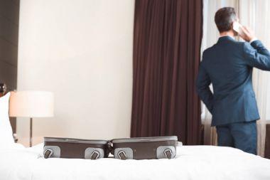 Businessman talking on phone in hotel room