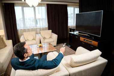 Businessman watching television