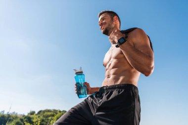 sportsman with sport bottle