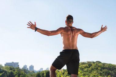 shirtless sportsman celebrating triumph