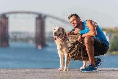 sportswoman with dog on quay