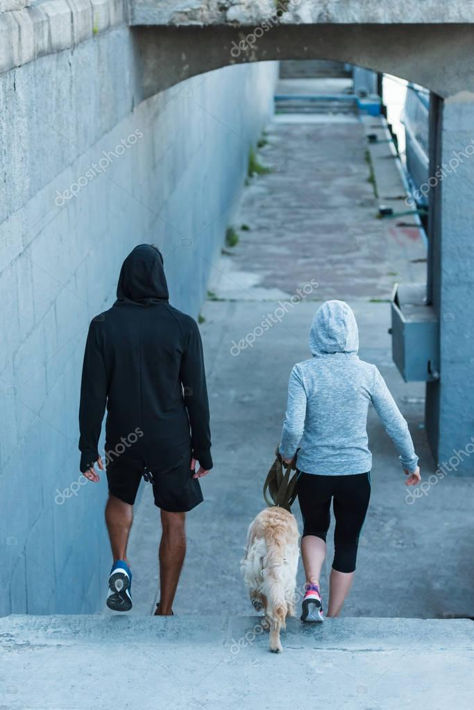 couple walking with dog