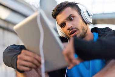 man with tablet and headphones