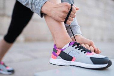 tying shoelaces on sneakers