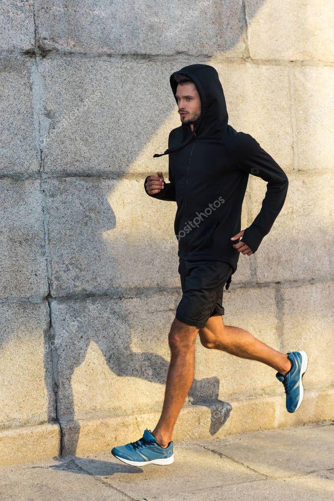 sportsman running at wall