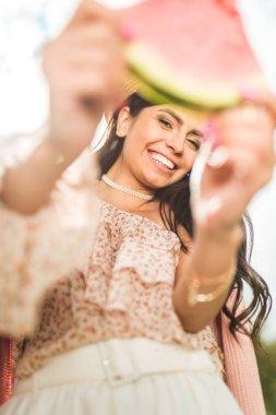 girl holding slice of watermelon