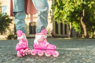 stylish girl in roller skates