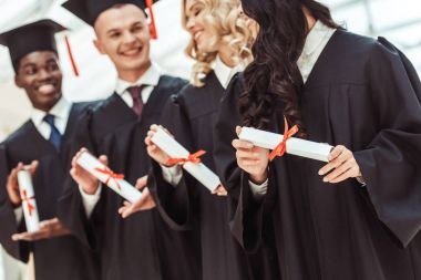multiethnic students with diplomas
