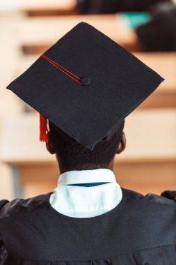 student in graduation hat