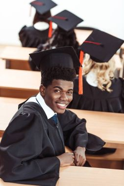african american student in graduation costume