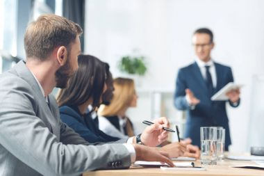 businesspeople in conference hall