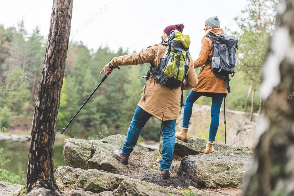 couple trekking in forest