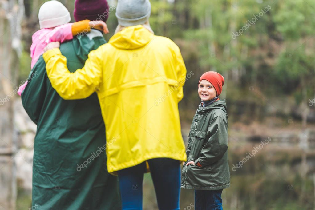 smiling boy looking at family
