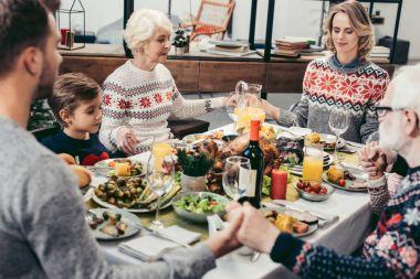 family praying at christmas table