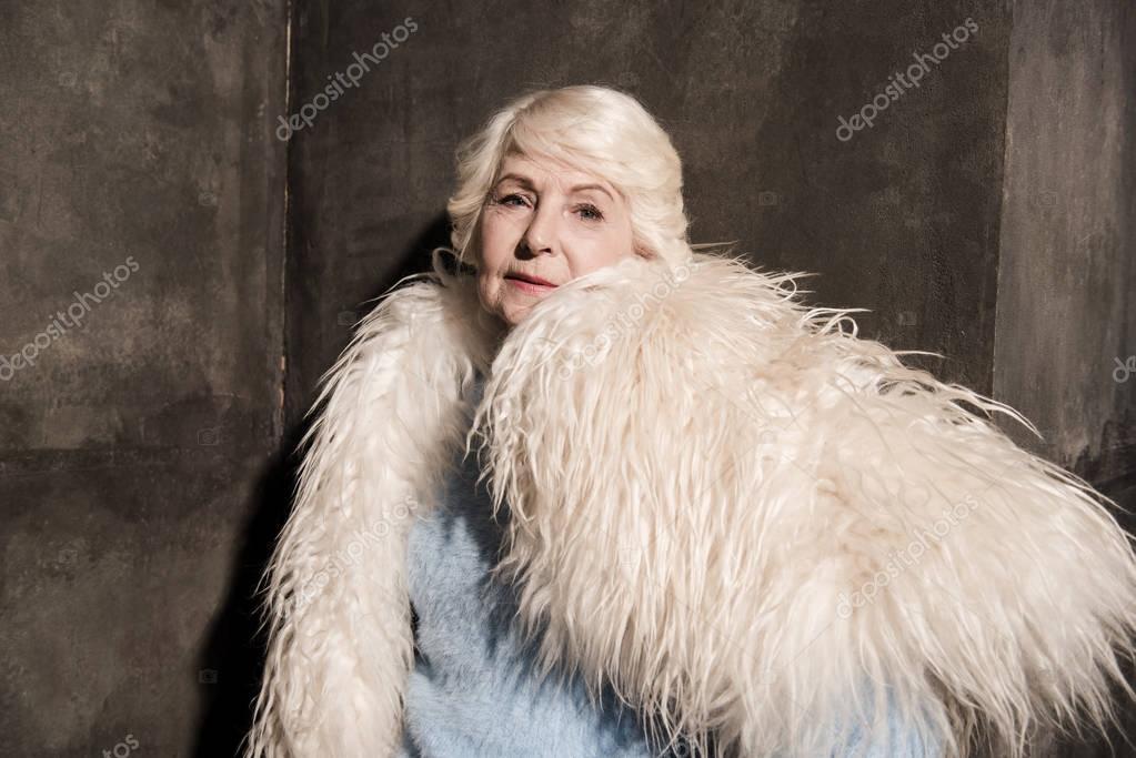 senior woman in fur coat