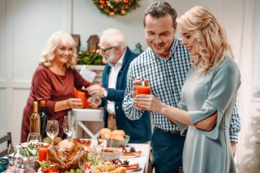 couples decorating christmas table