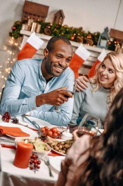 young muliethnic couple celebrating christmas