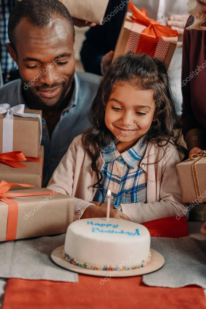 father and daughter with birthday cake