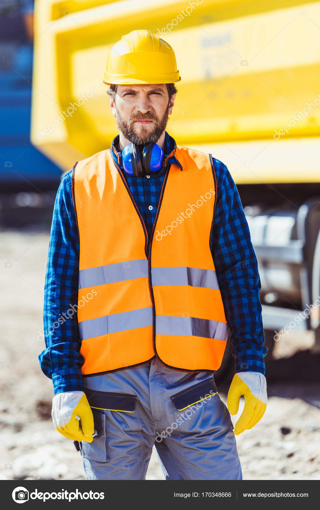 construction worker in hardhat and vest stock photo