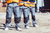 Fotografie Three builders at construction site