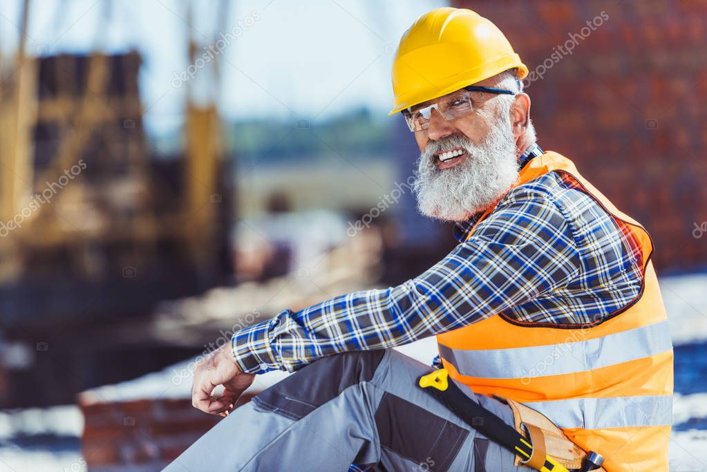 worker in protective wear at construction site