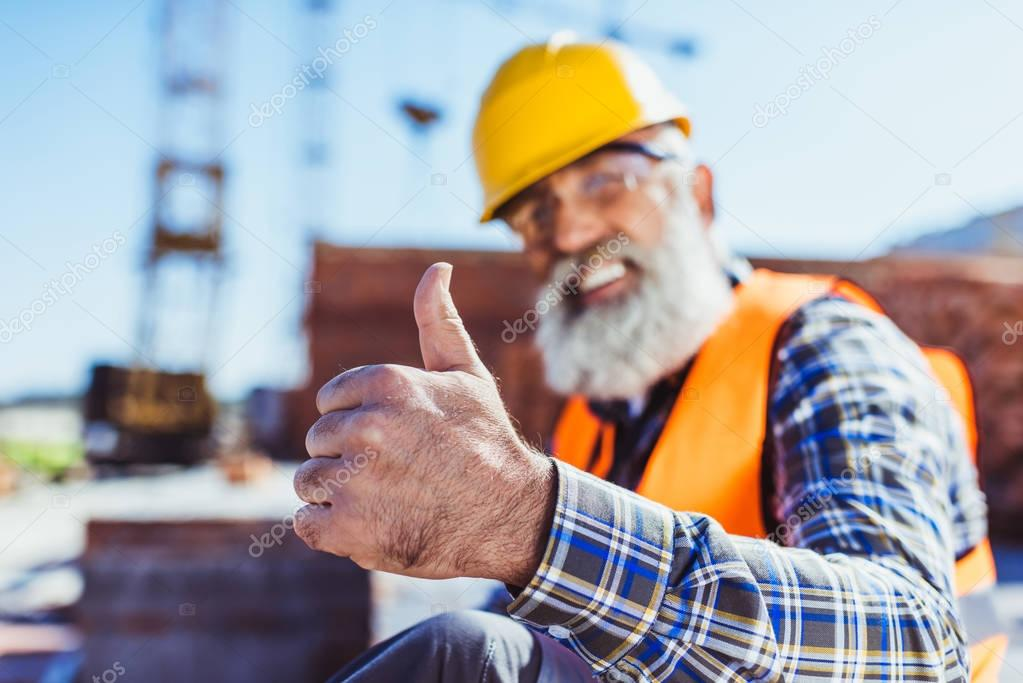 Construction worker showing thumb up