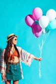 Fotografie Hippie woman holding colored balloons