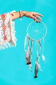 Fényképek hippi lány a kezében tartja a Álomfogó