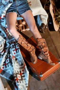 female hippie legs on suitcase