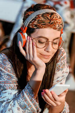 woman in boho style listening to music