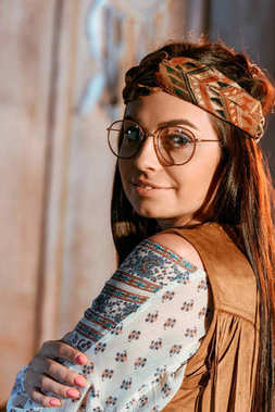 bohemian girl in headband and glasses