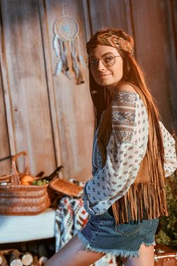 bohemian girl in headband and glasses
